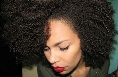 An array of textures throughout this beautiful head of afro hair. Awesome curly fro. Curly afro hair.
