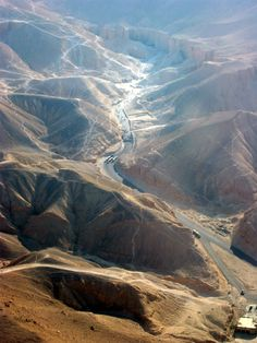 LOWER EGYPT: WEST BANK. The Valley of the Kings. Tourist trams navigate the bottom half of the photo.