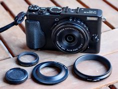 Fujifilm X70  Four pieces needed :  - The adapter Haoge LH-X49B (same adapter as FujiGlitch solution) : http://www.ebay.fr/i...ysAAOSwAvJW~Ldx - The lenshood JJC LN-RC49 : http://www.ebay.fr/i...=STRK:MEBIDX:IT - A filter 30,5mm (that you screw inside the lenshood) - A lens cap 30,5mm