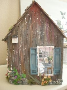 I got the artist's cottage dollhouse done.   The rose paintings were very easy to do. The potted flowers are all fabric I dyed and cut into...