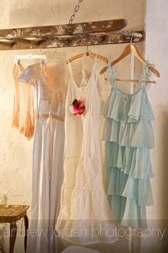 love ruffles and lace hanging from the old ladder~