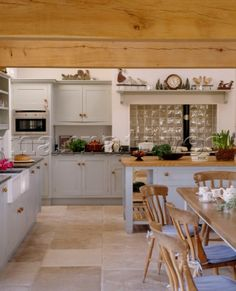 A Country Kitchen With Dining Area Beamed Ceiling Flagstone Floor Painted Units Central Island U