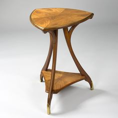 A French Art Nouveau two-tier tri-cornered table by Louis Majorelle.