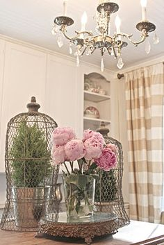 champagne check silk drapes and pink peonies.  Done to death?  Probably.  Don't care.  :)  love!
