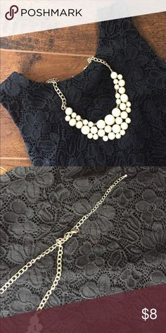 White bubble necklace A bit more of a creamy white, but really pops next to dark colors! Back of chain fading a bit, but not too noticeable. My go-to piece to dress up something simple! Purchased at a local boutique. Jewelry Necklaces