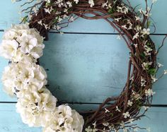 Decorate your front door, home, or even wedding ceremony this Summer or Autumn with this beautiful hydrangea wreath! This wreath is made from an 18 inch natural grapevine base, 9 beautiful hydrangea blooms in cream, olive green and orange along with realistic leaves. Accented with a beautiful script monogram of your choice! Measures approx. 22 inches in diameter and 6 inches in depth. This wreath also makes a perfect gift! Check out all of our Spring & Summer wreaths! https://w...