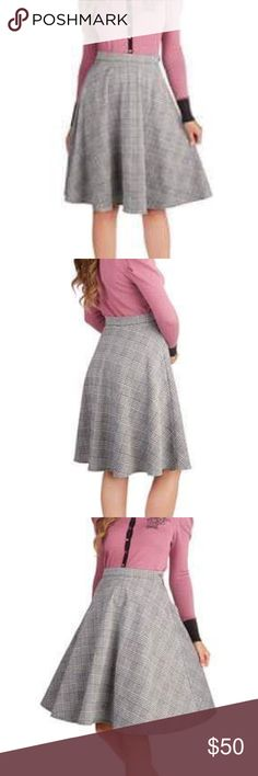 Ready Threads Skirt When you need a lovely look in a flash, this plaid skirt will always to lend a stylish hand! A checkered pattern of plaid and houndstooth adorns the A-line silhouette of this black-and-ivory garment, while a petite button closure adds a touch of charm to any ensemble.  - 97% Polyester, 3% Spandex. - Fabric provides stretch. - Hand wash. - Side zipper with button closure. Print placement may vary. - Imported Skirts A-Line or Full