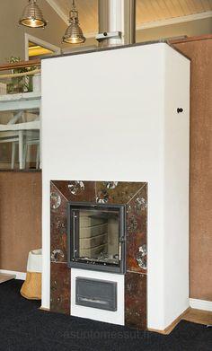 Tulikivi fireplace http://www.asuntomessut.fi/sites/default/files/imagecache/content/11_villagraniitti_takka.jpg