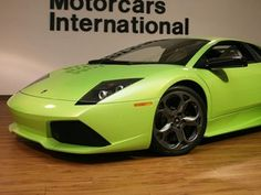 2009 Lamborghini Murcielago LP640 Coupe in Verde Ithaca (Pearl Green) over Nero Perseus/Avorio Lilium with Green Stitching. Only 1,412 miles. Built with E-Gear Transmission, AD PERSONAM Interior, Q-citura Leather Interior, Leather roof Lining, Carbon Ceramic Brakes, CI Badge Wheels, Black Brake Calipers, Branding Package, iPod, Hercules Titanium Wheels and Transparent Engine Bonnet. Original MSRP $393,860! Includes books, 2 keys, cover with bag, tools and original window sticker.