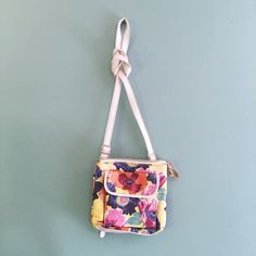 "Floral Relic Crossbody Bag Floral Relic Crossbody Bag by Fossil // 8.75"" wide x 8.5"" tall // 25.5"" long adjustable strap // so many pockets!! // one small stain on inner front pocket // clean interior // fun spring colors!! // non-smoking home // same or next day shipping! // 20% off 3+ Bundles // offers welcome // 5.7.35 Fossil Bags Crossbody Bags"