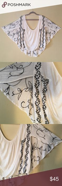 Women's Free People embroidered open back shirt White ivory linen shirt with intricate embroidery on back and front. Shirt is backless and has a extra piece of flowy cloth that hangs lower. Worn once!! :)) super cute with black jeans Free People Tops Blouses