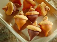Acorn candy -mini vanilla wafers, peanut butter chips, herseys kisses, & frosting