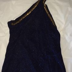 Sparkly midnight blue halter top with gold trim Gorgeous unique piece for your wardrobe! Dark royal midnight blue sparkles gold trim ties behind neck. I wore one time (I am allergic to sparkles- legit no kidding).:( Tops Tunics