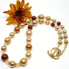 Rich autumn shades of gold, bronze, copper, Bordeaux and champagne are used to create this elegant Swarvoski crystal pearl necklace.  Perfect for stepping into the upcoming holidays.  Swarovski...@ artfire
