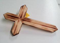 Handmade medium sized pine wooden wall cross, burned wood style. approximately 12 tall x 7 1/2 wide x 5/8 thick. Hand rubbed Danish oil finish. Sawtooth hanger on back. Makes a great gift for Christmas, baptism, house warming, weddings, etc. Grain patterns vary. Made with care in the USA.