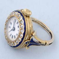 late 19th Century Swiss cylinder in a gold and enamel ring watch set with diamonds. Wow