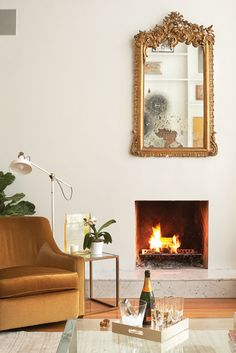 fireplace + antique mirror