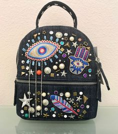 Steve Madden Hamsa Evil Eye Denim Mini Backpack