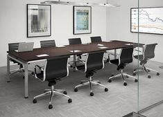 Blade conference table. Perfect color top and legs. Would like chairs better if they were armless. Great combo: dark wood, black leather, chrome/stainless accents