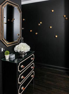 Black Foyer Walls with Black Ikea Chest