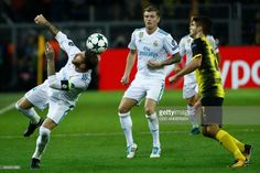 Real Madrid's defender from Spain Sergio Ramos (L) heads the ball during the UEFA Champions League Group H football match BVB Borussia Dortmund v Real Madrid in Dortmund, western Germany on September 26, 2017. / AFP PHOTO / Odd ANDERSEN