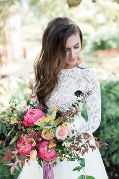 I'm a sucker for a pretty blush and white wedding, but this inspiration shoot fromCarlie Statsky PhotographyandEngaged & Inspiredis taking me over to the colorful side. The combination of the bright pink, dusty rose, and marigold yellow florals fromMandolin Floralagainst the