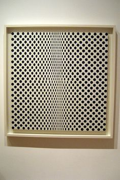 NYC - MoMA: Bridget Riley's Fission by wallyg, via Flickr ::: The distortion of the black dots at this painting's center creates the optical illusion that the image surface is caving in.