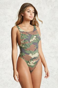 A knit sleeveless bodysuit featuring an allover pixelated camo design, round neckline, snap-button closure and scoop back.