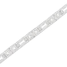 Art Deco Platinum and Diamond Bracelet, Van Cleef & Arpels  Composed of alternating stylized scroll links and modified buckle links, joined by bar links, set throughout with 288 old European and single-cut diamonds approximately 14.00 cts., signed V.C.A. N.Y., no. 15861, circa 1930, approximately 22.3 dwts. Length 7 3/16 inches