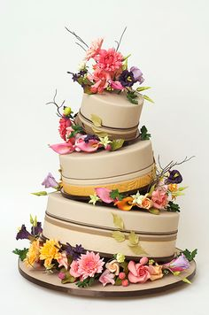 This topsy turvy wedding cake designed by Ron Ben-Israel cakes is a fun choice for a wedding in the garden.