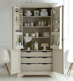 Larder cupboard to fit in under stairs space. Shelves for crockery and drawers for dish towels, napkins, table mats etc.