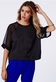 This season is all about #shelltops, textures and contrasting materials so this beauty has every box ticked straight away. In #silk feel fabric with #chiffon sleeves this updated style is easy to rock in any trend. With button fastening detail at the back, and turned up hems on the sleeves and waist, this feature style is a must have. #OOTD #AW14