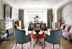 A gorgeous blend of classic furniture, bright colours and interesting antiques - interiors/ french/ colour/ eclectic/ parquet floor