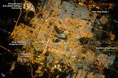 The population of Riyadh, the capital city of Saudi Arabia, has risen dramatically in the last half century—from 150,000 in 1960 to 5.4 million in 2012. The city appears as a brightly colored patchwork in this nighttime astronaut photograph. The brightest lights, apart from those on the old Riyadh Airbase, follow the commercial districts along King Abdullah Road and King Fahd Branch Road. Many of the darker patches within the built area are city parks.