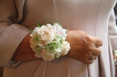 We'd created a Wrist Corsage for the Bride's Mum using Bombastic Roses with Astrantia and Palest Pink Hydrangea Florets