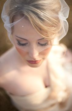 Ivory tulle birdcage veil kissed with delicate Swarovski crystals