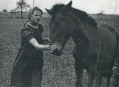 """Photo of Sophie Scholl with a horse. From, """"At the Heart of the White Rose: Letters and Diaries of Hans and Sophie Scholl."""""""