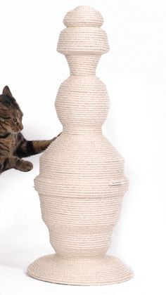 """Cats in Style"" - Designer Cat Products - The Green Head. Love the shape AND FUNCTION:) #cats #CatScratcher"