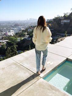 Jayne Min // wavy hair, oversized shirt, slouchy boyfriend jeans & slip-on flats #style #fashion