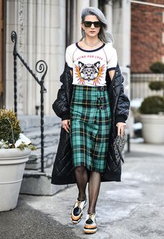 NEW YORK, NY - FEBRUARY 10:  Samantha Angelo is seen wearing a Gucci top, Guccie plaid skirt, Stella McCartney coat, Missoni shoes, Dita Eyewear sunglasses, Gucci bag and Jennifer Fisher earrings outside of the Milly show during New York Fashion Week: Women's Fall/Winter 2017 on February 10, 2017 in New York City.  (Photo by Daniel Zuchnik/Getty Images) via @AOL_Lifestyle Read more…