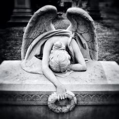 This is an amazing sculpture at Green-Wood Cemetery. While all the other angels are standing and pointing at the sky, this one isn't. Just poignant emotion.