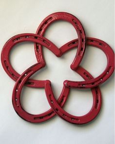 """Five horseshoes creatively intertwine to make a unique star design and become a conversation piece that is perfect for the walls of your home or barn. This specific horseshoe star measures approximately 10"""" in both height and width. This specific horseshoe art star wreath has been painted watermelon pink and distressed to give it a vintage authentic look. It also has been coated with two coats of glaze to protect it and keep it looking great for years to come. Any little cowgirl would love…"""