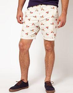 Pantalones cortos chinos con estampado de plumas de ASOS Stampe A Tema  Piume f00b190a6b04