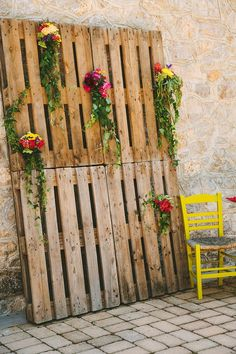 DIY crates to display flowers. http://www.weddingchicks.com/2014/08/06/bright-and-colorful-greece-wedding/