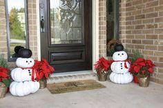 Reuse your leftover Halloween pumpkins to make snowmen.