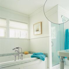 Federal crown molding adds to other old-fashioned details that distract from the bath's modern amenities, like an air-jet tub.