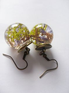 Glass orb earrings with flowers and moss in resin by zusnA on Etsy