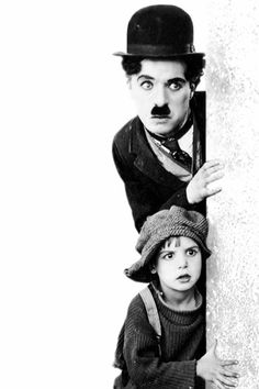 """Promotional Shot For """"The Kid"""" - Charlie Chaplin As The Tramp & Jackie Coogan As """"The Kid"""" (Years Before He Portrayed Uncle Fester In The TV Show """"The Addams Family"""""""