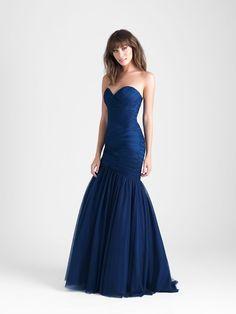 1964f70a84f This strapless tulle gown accents your curves with a pleated
