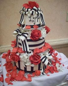 Black and White Striped Wedding Cake with Red Flowers